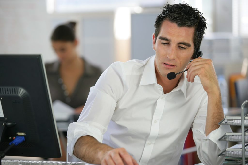 Call centre agent helping a customer.