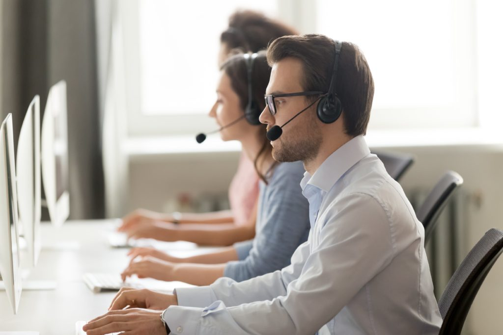 Call centre agents speaking on the phone.