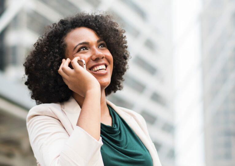 Happy customer on the phone.