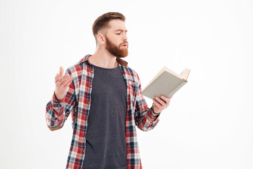 Man reading a script.