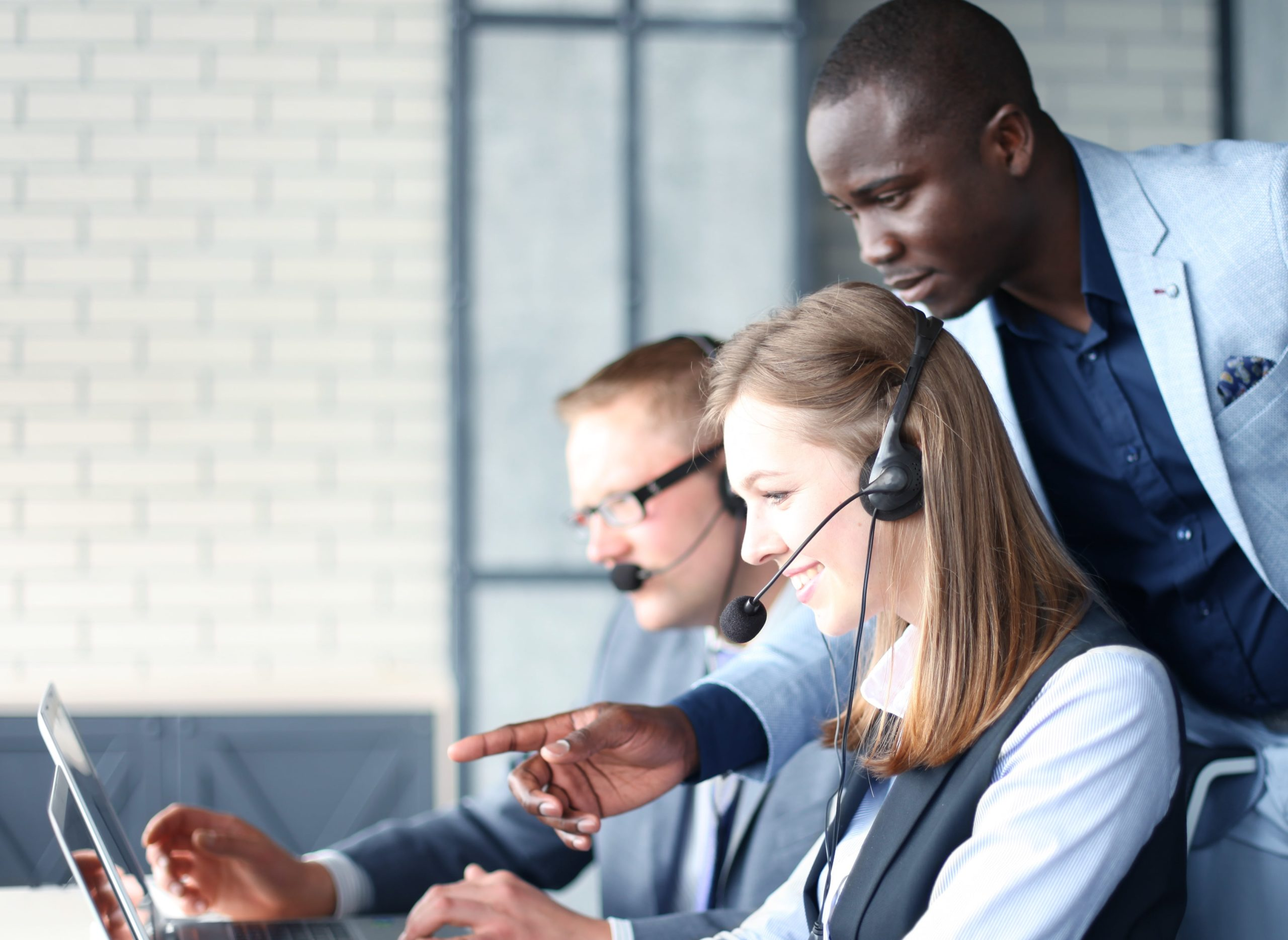 Manager training contact centre agents.