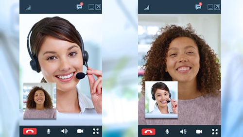 A contact centre agent communicating using video.